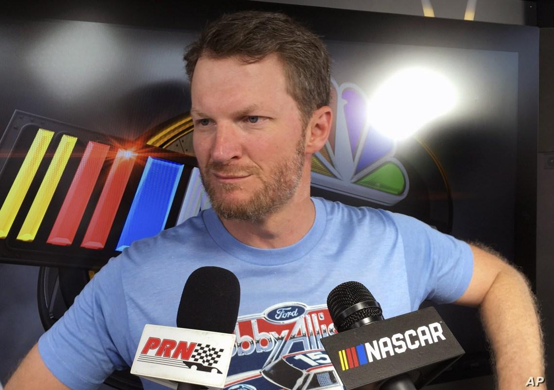 FILE - Dale Earnhardt Jr. talks to reporters during NASCAR auto racing pre-race activities at Daytona International Speedway in Daytona Beach, Fla., July 6, 2018.
