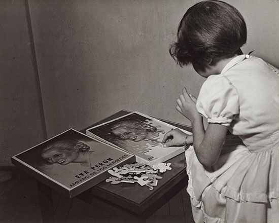 Evita_Peron_a_puzzle_subject_with_a_little_girl_1950