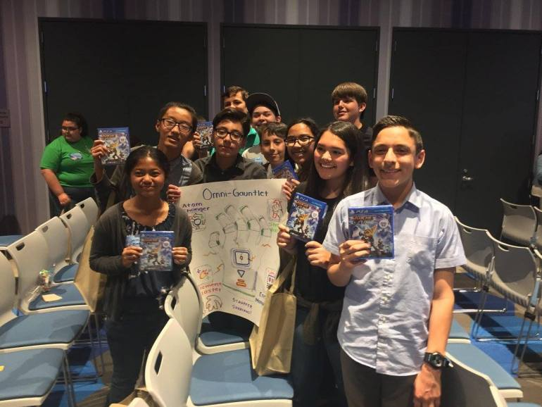 "The winning team celebrates with their own copies of the Ratchet & Clank game at the Google Venice ""Junior Galactic Rangers"" event"