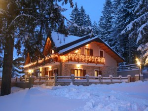 La Pinetina Residence exterior in the snow