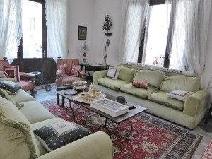The cosy lounge with sofas and armchairs and coffee table in the middle