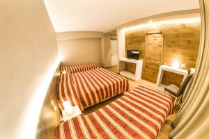 Grand Hotel Europa superior quad bedroom