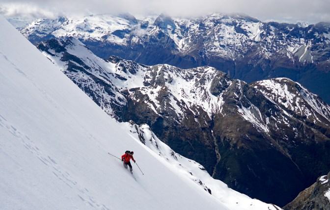 Peter White skiing off the summit of Somnus