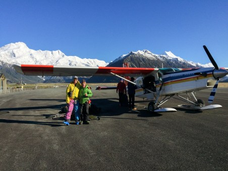 Joel & Marko posing in front of the Ski Plane at Mt Cook Airport.