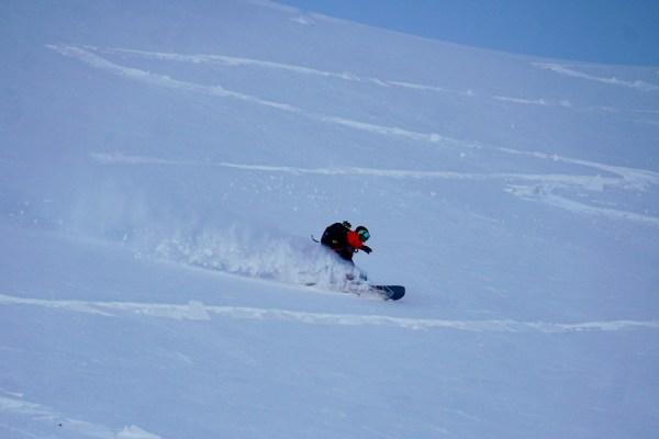 Nate snowboarding down the south face of Sakushidake