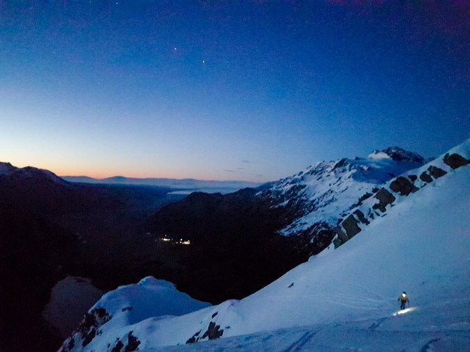 Joel skinning up pre-dawn from Sefton Bivouac