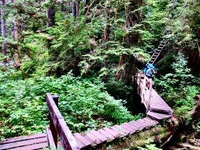 When people ask what the hardest part of the trip was- I tell them it was keeping my footing on tilted decaying mud and rain-slick boardwalks.