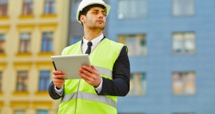 Businessman Using Tablet at Construction Site