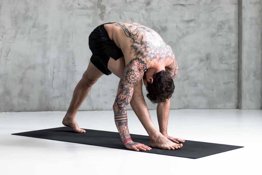 man stretching in yoga