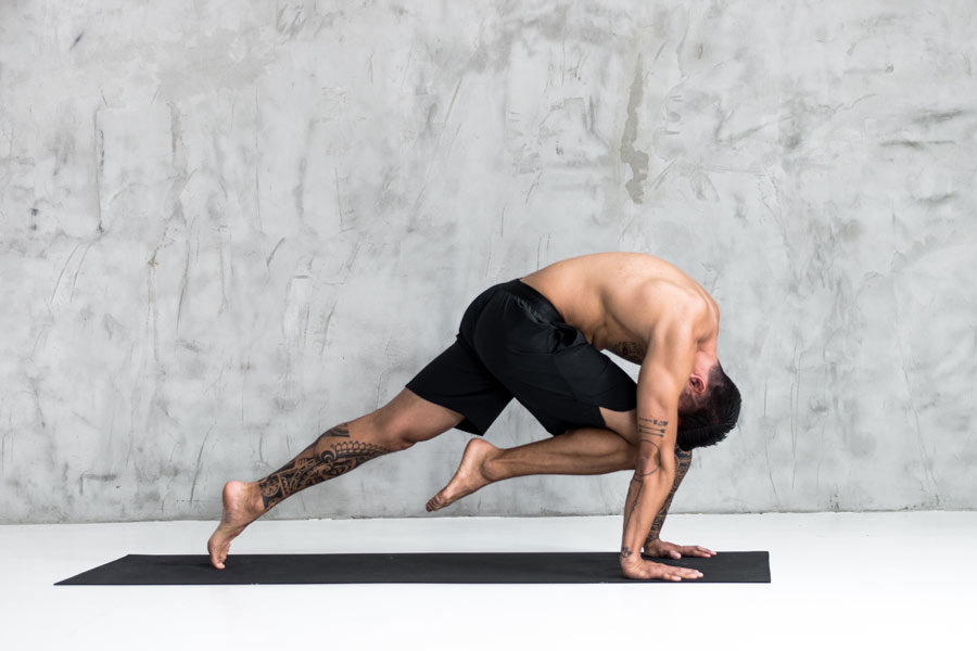 man doing yoga pose