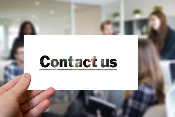 Contact Us Sign on cardboard paper
