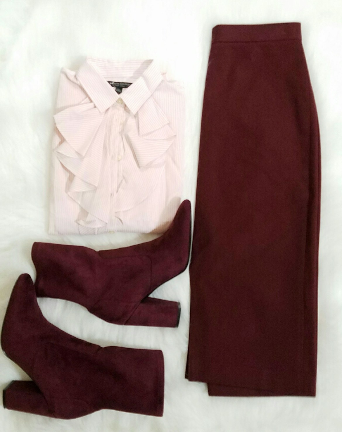 Perfect look for a day at work.  Love the boot and  skirt with the same color