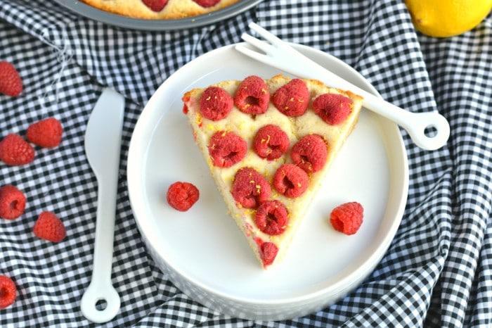 Bursting with lemon and with swirls of fresh raspberries, this elegant and Healthy Raspberry Lemon Cake is healthier cake to enjoy!