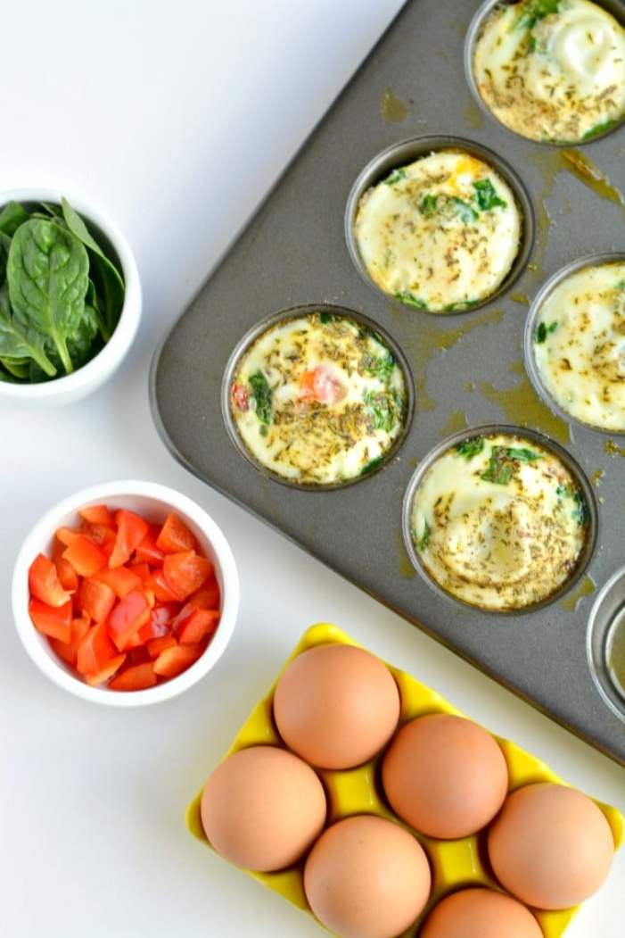 Whip up a batch of these Easy Spinach & Pepper Egg Muffins over the weekend for a protein packed breakfast you can take with you all week long! They're low calorie, gluten free, Paleo and simply delicious!