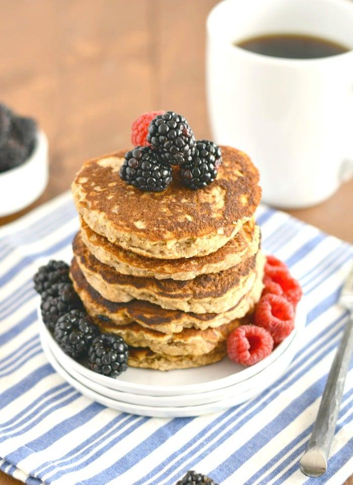 Perfect Paleo Coconut Pancakes! Thick and dense, this healthy stack is packed with fiber and protein and are guaranteed to keep you full. Gluten free, Paleo and low calorie they're sure to become your favorite go-to breakfast!