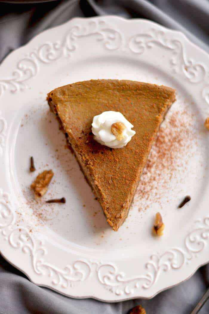 This Healthy Pumpkin Pie made with an addicting walnut date crust & topped with pumpkin custard is super easy to make & so delicious you won't want to share! What pumpkin pie dreams are made of! Gluten Free + Low Calorie + Paleo