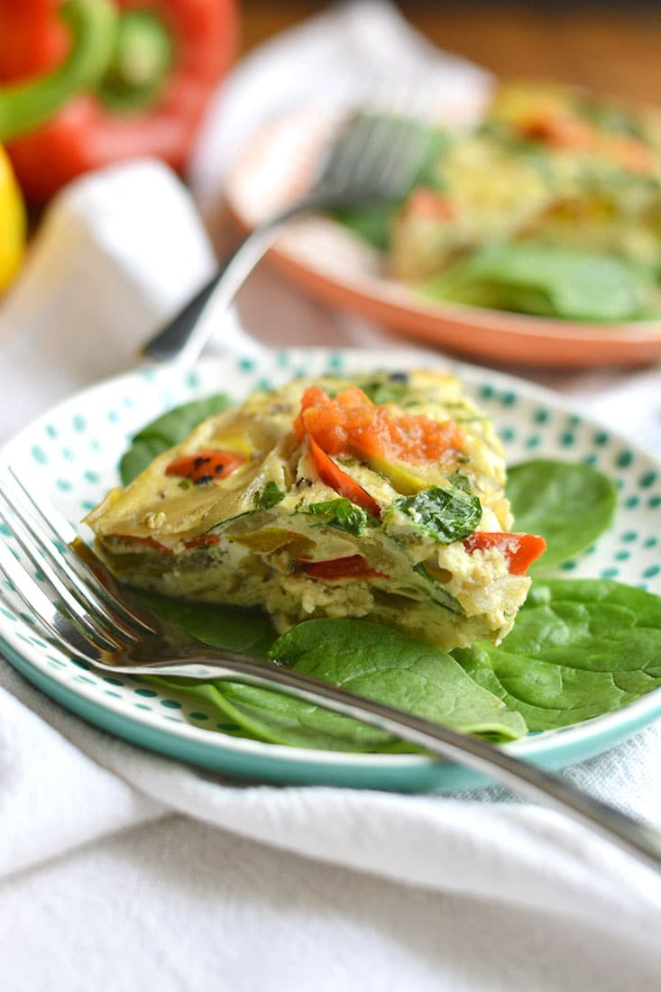 Crockpot Veggie Omelet! Make breakfast easy by letting the slow cooker do the work! This simple make ahead breakfast is loaded with vegetable & protein. The perfect way to start the day. Paleo + Gluten Free + Low Calorie!
