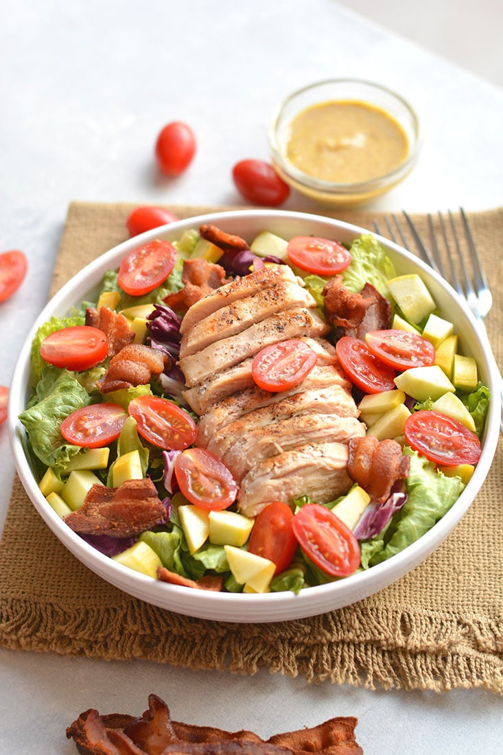 A classic BLT Grilled Chicken Salad! Fresh lettuce topped with tomatoes, squash, crispy bacon & drizzled in a balsamic mustard dressing! Great for lunch or dinner! Gluten Free + Low Calorie + Paleo
