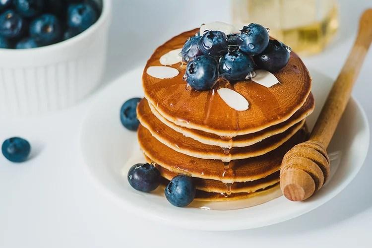 Greek yogurt pancakes with blueberries and honey
