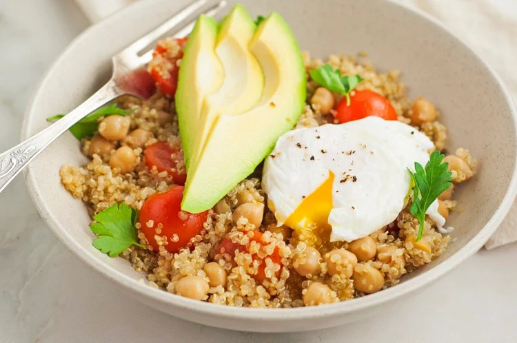 Perfect quinoa bowl with avocado and poached egg