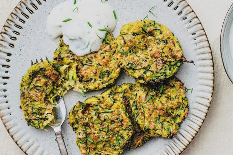 Zucchini fritters with vegan sour cream sauce