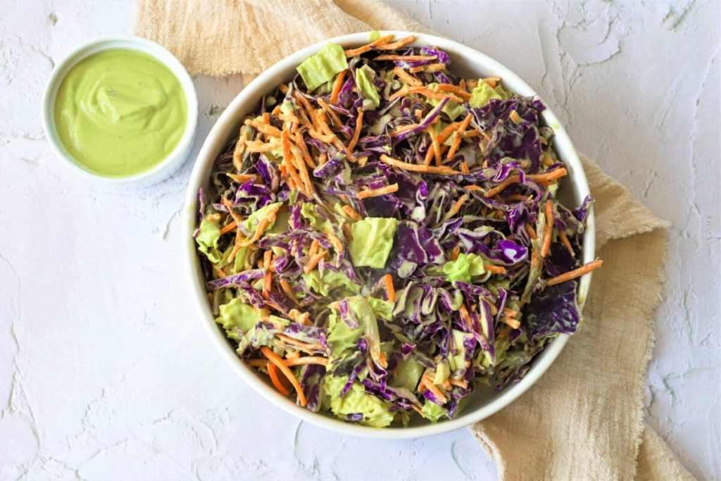 This creamy vegan coleslaw gets its smooth texture from avocado instead of mayo!