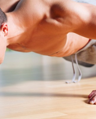 Young man doing push ups