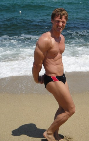 Christopher Maslon flexing at the beach