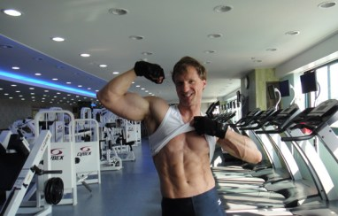Christopher Maslon flexing at the gym