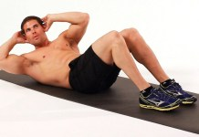 A man doing crunches on a mat