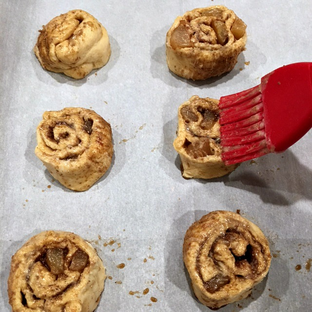 brushing-apple-pie-cinnamon-buns-with-butter