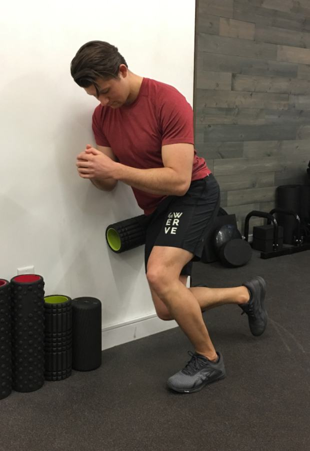 IT Band Stretches: Standing Wall Squat