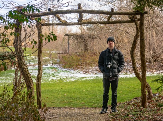 Michael standing in the entrance to the wildflower garden