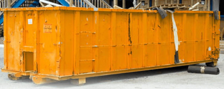 Large yellow commercial skip