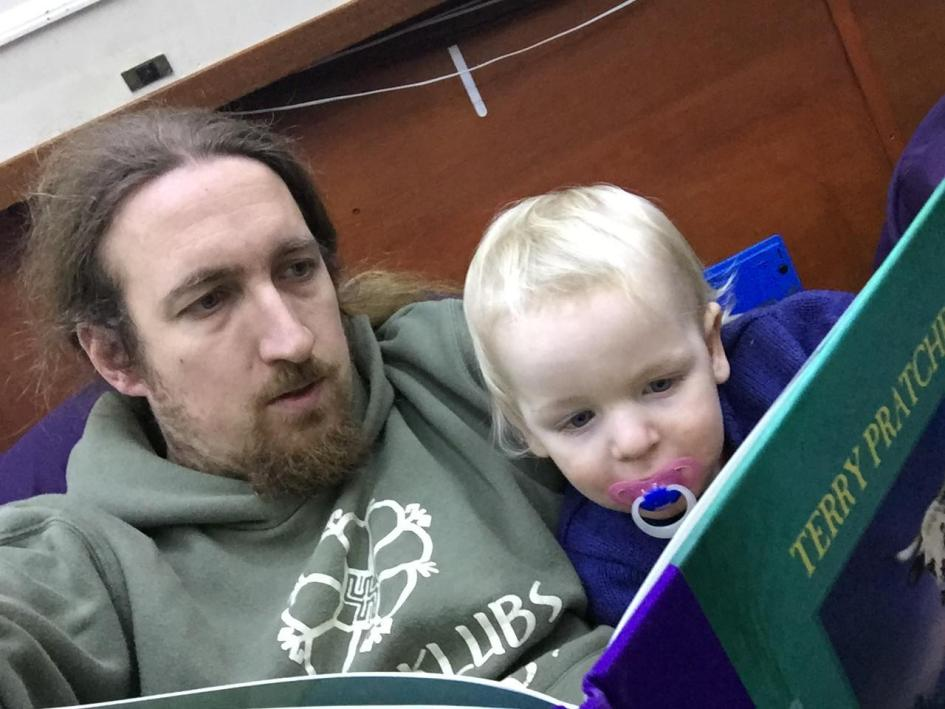 MiniBoyGeek and I reading a book