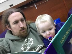 Me and MiniBoyGeek, reading a book