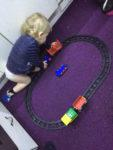 MiniBoyGeek playing with a Lego Duplo Train