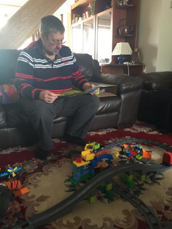 Granddad studying the instructions