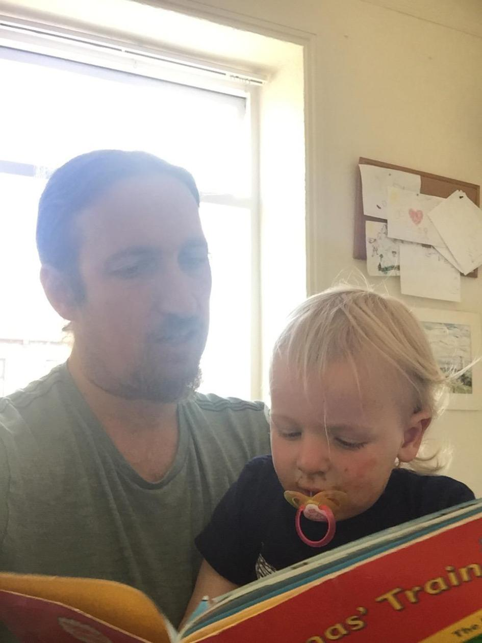 Mini Boy Geek and Skippy reading a book