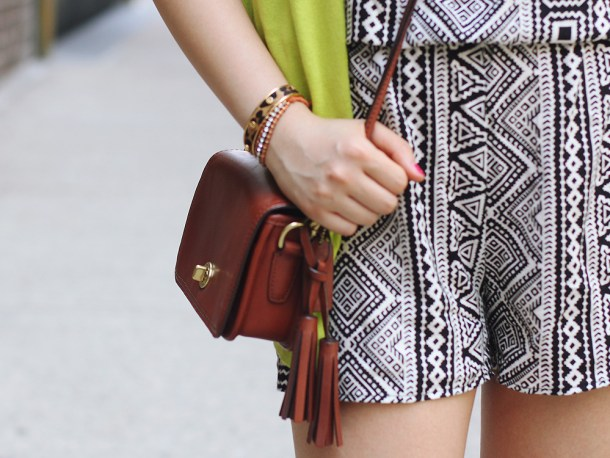 Skirt The Rules Blog; NYC fashion blogger; style blog; summer outfit photo; black and white tribal romper; Gap Luxe Light neon green cardigan; Courtney Kerr x Bauble Bar Neon Alaqua tribal statement necklace; CC Skye geometric gold bracelet; Coach Legacy Penny brown crossbody bag; C. Wonder leopard calf hair skinny bangle; Sam Edelman Sophie black and brown colorblock wedges