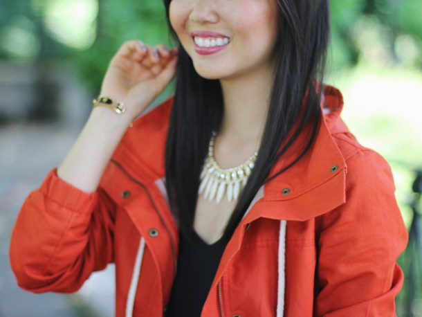 Red Anorak Jacket & Beige Talon Necklace