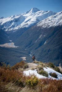 Skis on the pack on the Cascade Saddle track with Mt Aspiring in background