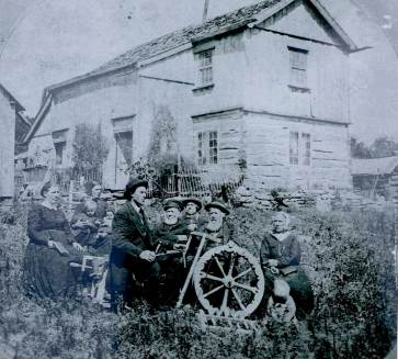 Aslak Olsen Lie, nr 2 from the right, and his family in front of his home in Wisconsin in 1874. Photo. Andrew Dahl
