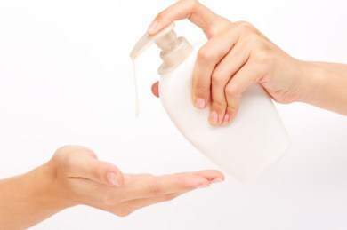 hands-applying-white-liquid-soap_1098-4001