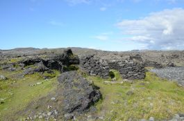 The remains of shelters built of hewn lava. They look recent enough that they are probably not the remains of housing for fishermen, but rather shelters for soldiers guarding the coast during the Second World War.