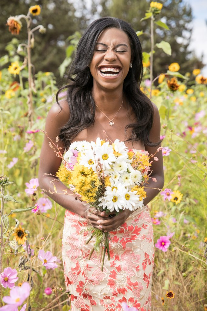 black bride laughing in wildflowers