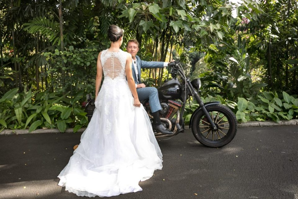 button back long bridal gown with motorcyle