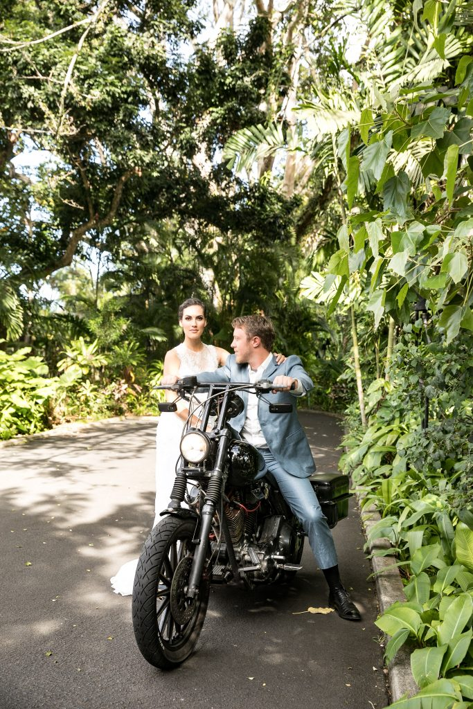 couple ride on harley motorcycle exit