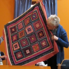 Quilt with multiple squares within squares