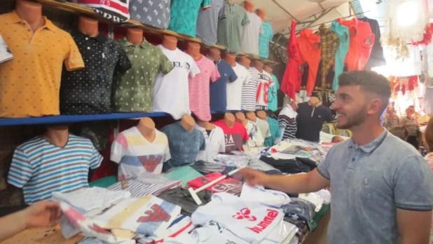 Shirt Vendor in Bazaar